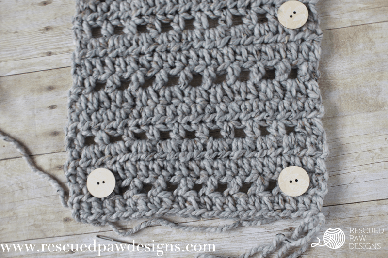 How to attach buttons to a scarf