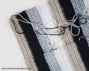 Striped Pillow Crochet Pattern by Rescued Paw Designs. Click to through to read this simple tutorial to make one today!