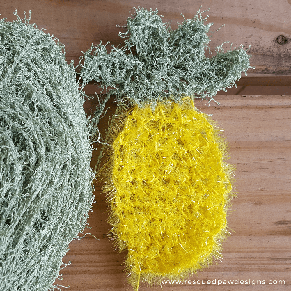Pineapple scrubby FREE Crochet Pattern by Rescued Paw Designs. www.rescuedpawdesigns.com. Click to Read or Pin and Save for Later!