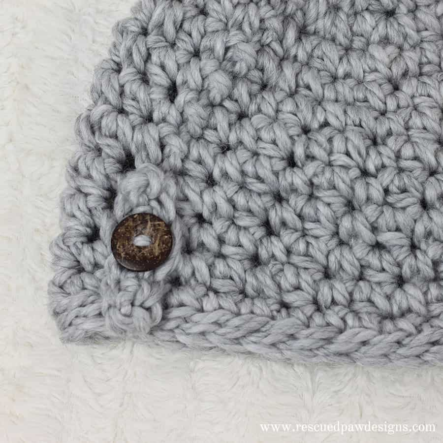 Free Messy Bun Beanie Crochet Pattern by Rescued Paw Designs. Try this FREE pattern today!