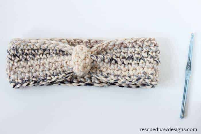 Snowy Earwarmer Crochet Pattern by Rescued Paw Designs - Make this easy beginner friendly pattern today!