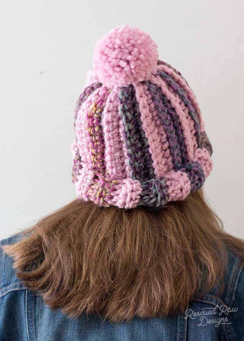 Back view of a pink striped crochet hat