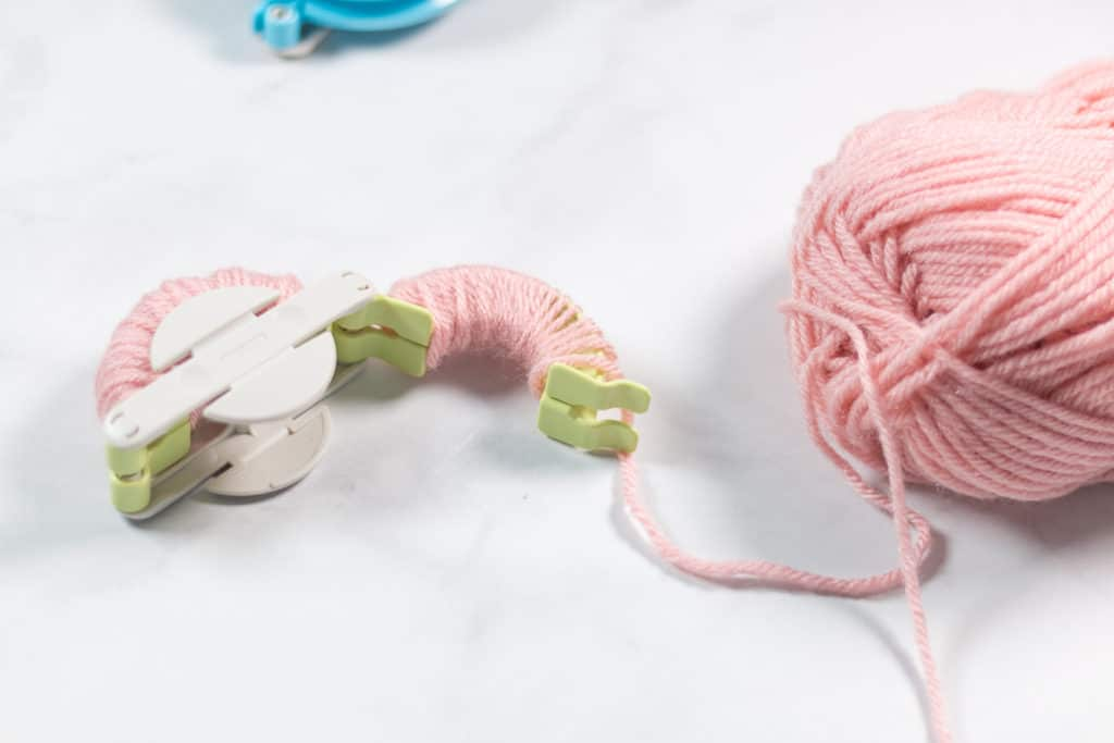 How to wrap yarn on a Clover Pom Pom Maker