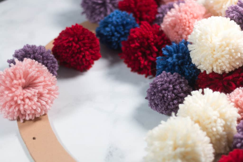 Placement of Pom Poms on wreath